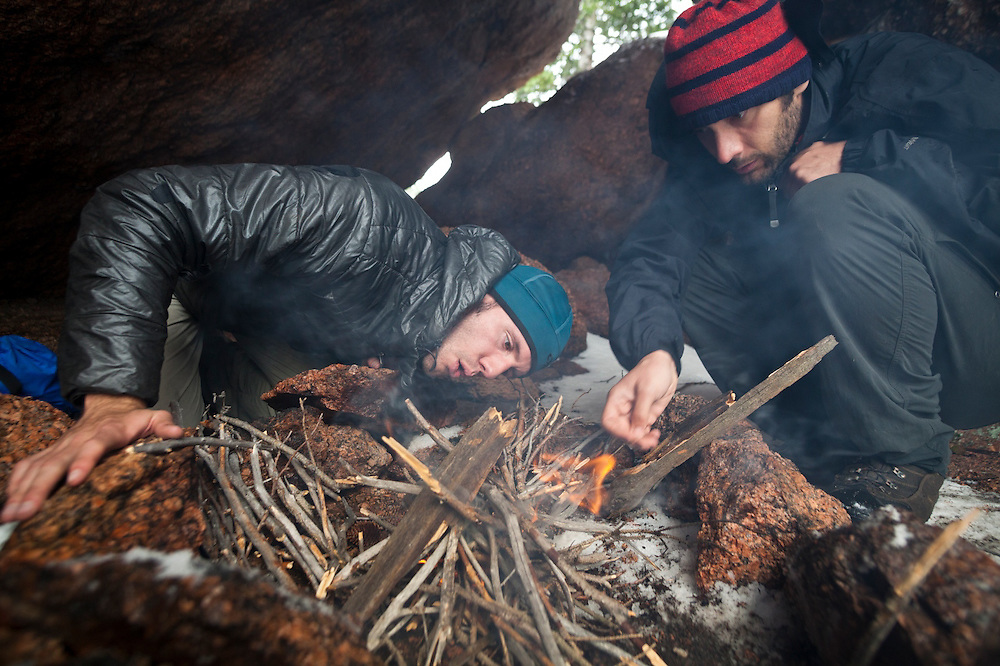Obadiah Reid (left) and Marco Binotti start a fire at their campsite in a cave in McCurdy Park, Lost Creek Wilderness, Colorado.