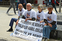 June 10, 2017 - Ankara, Turkey - A group of elderly people stage a sit-in to support sacked academic Nuriye Gulmen and primary school teacher Semih Ozakca, who were arrested by a court decision on the 76th day of their hunger strike, in Ankara, Turkey on June 10, 2017. The protesters wear t-shirts with a symbolic drawing of the educators' portraits in order to protest against the arrest. (Credit Image: © Altan Gocher/NurPhoto via ZUMA Press)