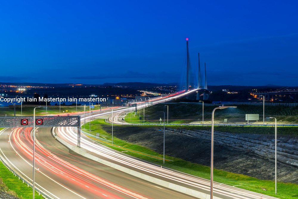 Evening view of new Queensferry Crossing at dusk with traffic on approach highway with long exposure,  in Scotland, United Kingdom
