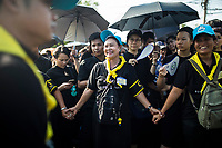 Volunteers help control crowds for the late king's funeral near the Grand Palace in Bangkok, Thailand. Hundreds of thousands of people, dressed in black, have gathered in Bangkok over a year after the death of Thailand's popular King Bhumibol Adulyadej.  The five-day royal cremation ceremony is taking place between October 25-29 in Bangkok's historic Grand Palace and the Sanam Luang area.