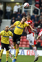 Photo: Mark Stephenson/Sportsbeat Images.<br /> Stoke City v Watford. Coca Cola Championship. 09/12/2007.Watford's Tamas Priskin wins the ball from Stokes Carl Dickinson