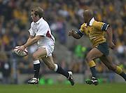 Twickenham, England, Autumn International. RFU Twickenham Stadium<br /> 16/11/2002<br /> International Rugby - England vs Australia.<br /> James Simpson-Danials chased by George Gregan.         [Mandatory Credit:Peter SPURRIER/Intersport Images]