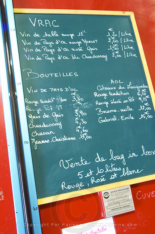 Calk board with wines for sale: Vrac, bulk, table wine, Vins de Pays d'Oc, wine in bottle, Vin de Pays d'Oc and AOC, and BiB bag in box. Domaine Le Nouveau Monde. Terrasses de Beziers. Languedoc. France. Europe.