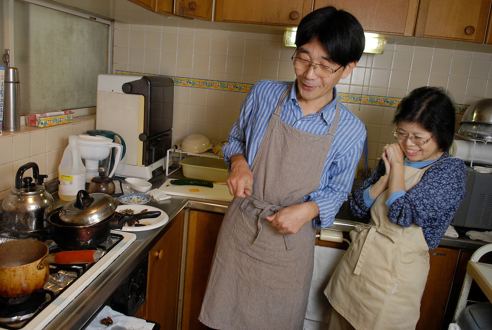 """Shoichi and Chisato Uchiyama cooking insects in their kitchen at home in Tokyo. Tokyo resident Shoichi Uchiyama is the author of """"Fun Insect Cooking"""". His blog on the topic gets 400 hits a day. He believes insects could one day be the solution to food shortages, and that rearing bugs at home could dispel food safety worries."""