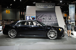 """08  February 2013: 2013 Chrysler 300C automobile. Chicago Auto Show, Chicago Automobile Trade Association (CATA), McCormick Place, Chicago Illinois<br /> <br /> 2013 Chrysler 300: Heading into 2013, the popular Chrysler 300 rear-wheel drive series has simplified product lineup and added more convenience and comfort on new base 300, 300S, 300C and top-tier 300C Luxury levels. (The Chrysler 300 SRT8 is covered separately.) A new edition for 2013 is the Chrysler 300 """"Glacier"""" that combines unique design appointments with all-wheel-drive capability to carve through some of the most snow-covered landscapes. Additional standard features on the 300 include heated leather seating, Uconnect 8.4 with voice command and 3.6-liter aluminum Pentastar V-6 engine with state-of-the-art ZF eight-speed automatic transmission. The Chrysler 300 AWD model offers even more all-season capability at a legendary value. For an added avant-garde appearance and performance, the 300S delivers the 3.6L V-6 with new sport-tuned exhaust system and cold-air induction system. This aluminum mill now produces 300 horsepower (8 more than last year) and has an enthusiast desired sound. Beats by Dr. Dre audio technology that includes a 522-watt 12-channel amplifier is standard on the Chrysler 300S and available on other 300 models. Stock powerplant on the 300C is the 363hp 5.7L V-8 with standard five-speed automatic transmissions. On the exterior, large 20-inch polished face wheels for rear-wheel drive only, and 19-inch with all-wheel drive, provide the sedans with an even more planted and road-holding look. Every 2013 Chrysler 300 variants come with a comfortable five-passenger cabin that exudes luxury, and a tailored trunk that can handle 16.3 cubic feet of luggage."""