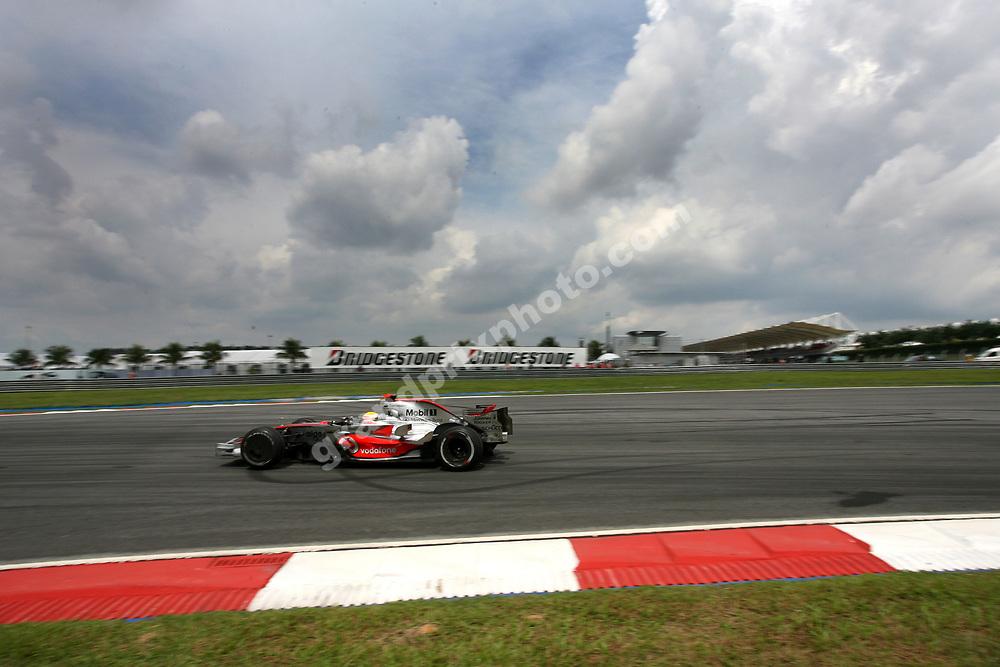 Lewis Hamilton (McLaren-Mercedes) under dark clouds in the 2008 Malaysian Grand Prix in Sepang. Photo: Grand Prix Photo