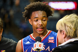 Jan 15, 2018; Morgantown, WV, USA; Kansas Jayhawks guard Devonte' Graham (4) talks with ESPN's Holly Rowe after beating the West Virginia Mountaineers at WVU Coliseum. Mandatory Credit: Ben Queen-USA TODAY Sports
