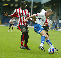Photo: Aidan Ellis.<br /> Bury FC v Brentford. Coca Cola League 2. 01/09/2007.<br /> Bury's Glynn Hurst holds off Brentford's Karleigh Osborne