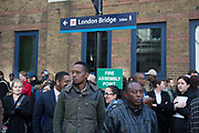 People being moved along after London Bridge Station was evacuated due to an abandoned vehicle on 7th March 2017, in London, United Kingdom. The area was cordoned off by police leaving hundreds of people beyond the police cordon. The vehicle had been deemed suspicious by the Metropolitan Police Service, and so the entire area was off limits while the emergency services and bomb squad dealt with the issue.