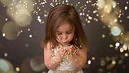 Young girl playing with sparkles, fairy dust, candid, natural, in studio, professional photographer, pro images, stylized pictures, posed, spontaneous, natural, posing,glitter,Franklin TN,