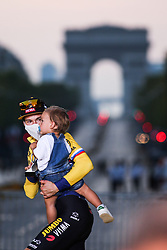 Jumbo Visma's rider Primoz Roglic, second overall, and his son on the podium of the Tour de France 2020, on Champs Elysees Avenue in Paris, on September 20, 2020. / Sportida