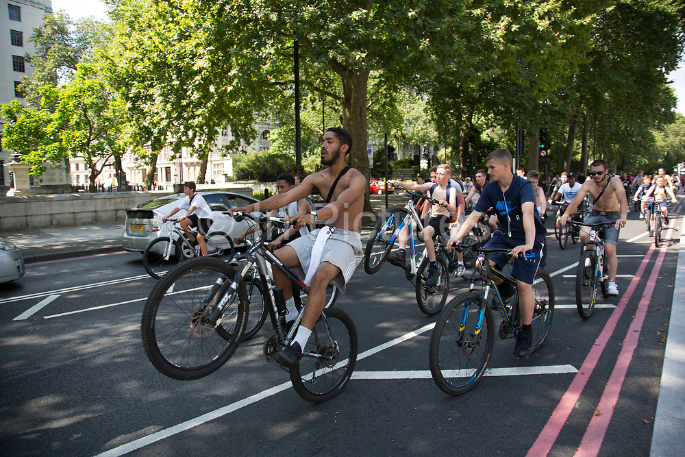 Thousands of cyclists from Bike Life block the street and wheelie their cycles along Victoria Embankment in London, England, United Kingdom. This was like a flash mob event, where suddenly the whole street was filled with bicycles that took over the streets.