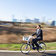 George Hendricks rides up the greenway near uptown on a B-Cycle-- the cities new bike share program.