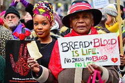 "© Licensed to London News Pictures. 19/01/2019. LONDON, UK.  Women at the head of the Women's March in the capital, one of 30 such worldwide marches protesting against violence against women and the negative impact of austerity policies.  London's theme this year is ""Bread and Roses"", honouring Polish-American suffragette Rose Schneiderman who, in 1911 said ""The worker must have bread but she must have roses too"", in response to a factory fire where 146 mainly female garment workers died.  Photo credit: Stephen Chung/LNP"