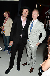 Left to right, JOHN TAYLOR and GARY KEMP at the opening of Club To Catwalk: London Fashion In The 1980's an exhibition at The V&A Museum, London on 8th July 2013.