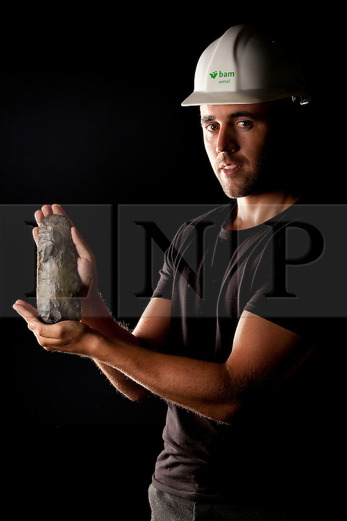 © Licensed to London News Pictures. 19/07/2012. LONDON, UK. Danny Murphy, a site engineer working on the 2012 London Olympics site in East London, holds a 6000 year old flint axe head at the museum today (19/0712).  The axe head is one of many artefacts that were unearthed by archaeologists ahead of the construction of the Olympic Park in East London which included findings from the Neolithic, Roman and Bronze Ages. Photo credit: Matt Cetti-Roberts/LNP