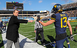 Nov 10, 2018; Morgantown, WV, USA; West Virginia Mountaineers athletic director Shane Lyons fist bumps West Virginia Mountaineers wide receiver David Sills V (13) before their game against the TCU Horned Frogs at Mountaineer Field at Milan Puskar Stadium. Mandatory Credit: Ben Queen-USA TODAY Sports