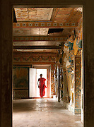 Young monk in a Buddhist temple in Mulkirigala Monastery, Sri Lanka