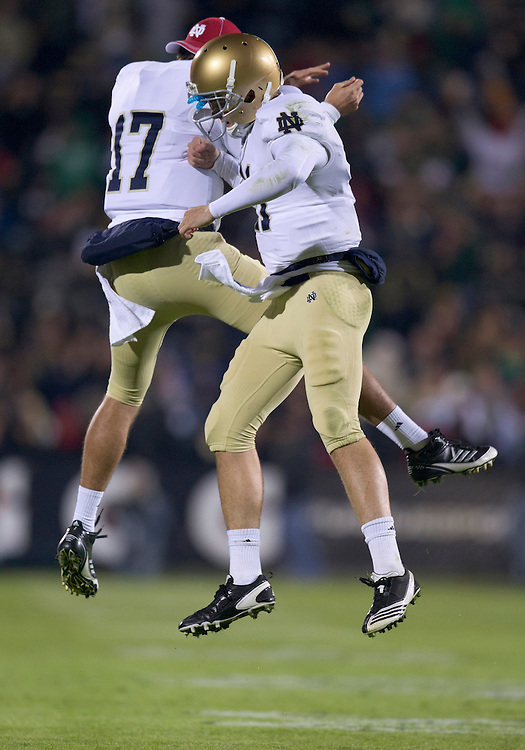 October 01, 2011:  Notre Dame quarterback Tommy Rees (#11) and backup quarterback Matthew Mulvey (#17) celebrate touchdown during NCAA Football game action between the Notre Dame Fighting Irish and the Purdue Boilermakers at Ross-Ade Stadium in West Lafayette, Indiana.  Notre Dame defeated Purdue 38-10.