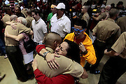 Odilia Hernandez sees her son Anthony Hernandez for the first time in 12 weeks as he is released to his family at the end of Liberty Ceremony.  The following day he will return home with his mother after graduation.  Marine Corps Recruit Depot at Parris Island in South Carolina is where all male recruits living east of the Mississippi River and all female recruits from all over the US receive their arduous twelve week training in their quest to become marines. Even though there are two current active wars and a weak economy, recruitment has not been effected.  Actually, recruiting numbers have increased, with more young men and women looking toward the military for answers.