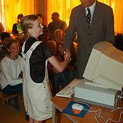 Rabobank schenkt computers aan verschillende scholen