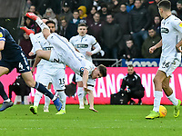 Football - 2018 / 2019 Sky Bet EFL Championship - Swansea City vs. Millwall<br /> <br /> Daniel James of Swansea City collides with Shaun Hutchinson of Millwall, at The Liberty Stadium.<br /> <br /> COLORSPORT/WINSTON BYNORTH