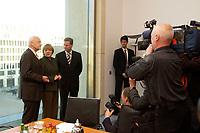 12 NOV 2003, BERLIN/GERMANY:<br /> Edmund Stoiber, CSU, Ministerpraesidnet Bayern, Angela Merkel, CDU Bundesvorsitzende, und Guido Westerwelle, FDP Bundesvorsitzender, (v.L.), vor Beginn eines Spitzentrfffens von Politiker der CDU/CSU und der FDP, axica Kongress- und Tagungszentrum<br /> IMAGE: 20031112-01-002<br /> KEYWORDS: Opposition, Spitzengespraech, Kamera, Camera, Journalist, Journalisten