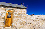 The summit hut and hikders on Mount Whitney, Sequoia National Park, Sierra Nevada Mountains, California USA