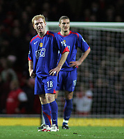 Photo: Paul Thomas.<br /> Arsenal v Manchester United. The Barclays Premiership. 21/01/2007.<br /> <br /> Paul Scholes (L) and Nemanja Vidic of Man Utd show their dejected after Arsenal score their first.