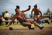 SAN MARTIN DE LAS PIRAMIDES, MEXICO - APRIL 15, 2017: A player receives and hits a rubber ball during a tourney of Ulamaztli, a Mesoamerican Ball Game. A player prepares himself to receive and hit a rubber ball during a tourney of Mesoamerican Ball Game titled Ulamaztli. To withstand the blow of the ball, that weighs 7 pounds, the players protect their hips with bandages and leather belts. Each team has 5 players and the game purpose is to keep the ball inside the play area without touch it with hands or another part of the body, except the hips. Rodrigo Cruz for The New York Times