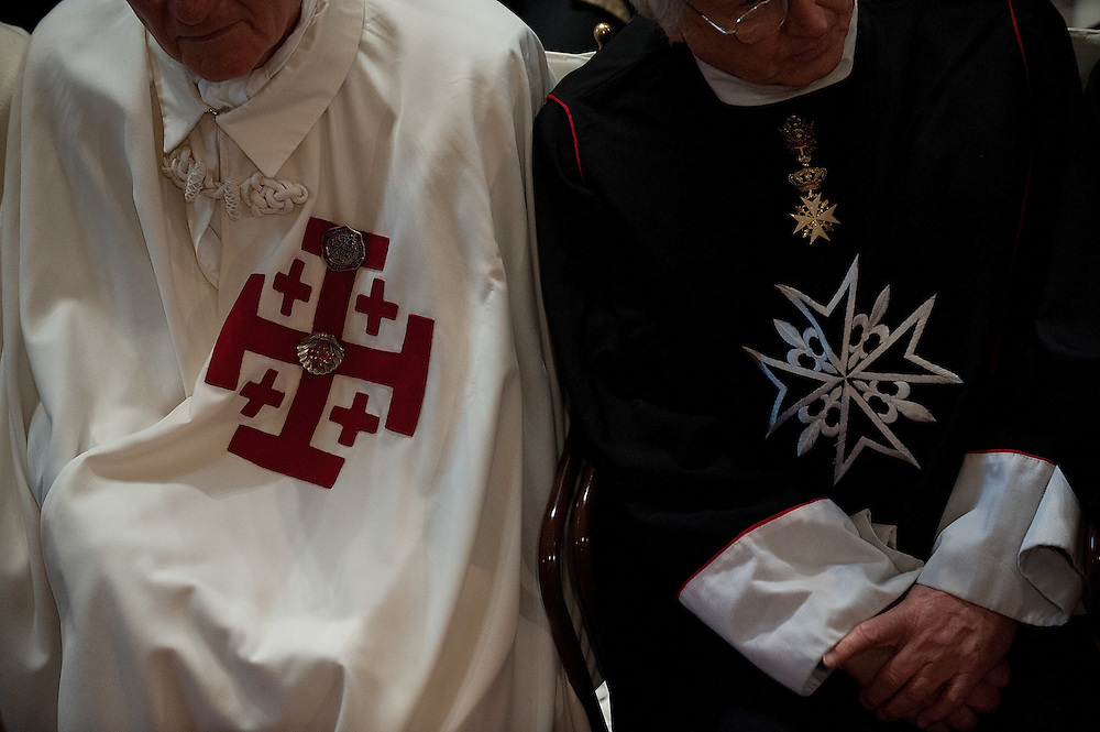VENICE, ITALY - MARCH 25:  A knight of the Order of Temple of Jerusalem (L) and a Knight of Malta (R) sit next to each other  during the solemn mass to welcome the newly appointed Patriarch of Venice Francesco Moraglia in St Mark's Cathedral on March 25, 2012 in Venice, Italy. The Patriarch of Venice is the smallest of the Italian dioceses but one of the oldest, created in 774. Three of the last seven Italian Pontiffs were Patriarch of Venice.  (Photo by Marco Secchi/Getty Images)