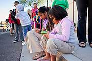 """Oct. 24, 2009 - SCOTTSDALE, AZ: Children play electronic game consoles while they wait to get H1N1 vaccinations at Scottsdale Healthcare's Community Health Services clinic Saturday morning. The first publicly administered H1N1 (""""swine flu"""") vaccinations were given in the Phoenix area Saturday. About 52,000 doses of the vaccine, in both injection and nasal spray form, were available on a first come first served basis, but only to those in so called """"high risk"""" groups: pregnant women, children 6 months to 4 years old, children 5 years to 18 years with underlying health concerns and direct caregivers of infants less than 6 months old. More than 700 people lined up at Scottsdale Health Care, which had 500 doses of the vaccine to administer.     Photo by Jack Kurtz"""