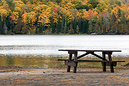 A park bench near the end of the season at Lac Philippe in Gatineau Park.  Photographed from Breton Beach on the shore of Lac Philippe.