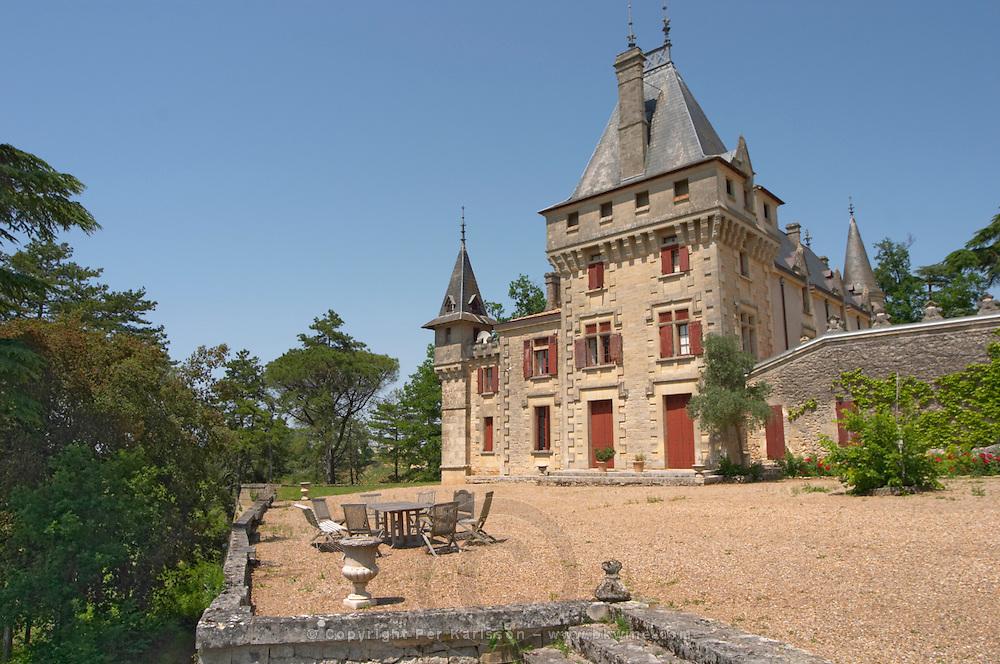 The magnificent Chateau de Pressac and garden furniture on the terrace Chateau de Pressac St Etienne de Lisse Saint Emilion Bordeaux Gironde Aquitaine France