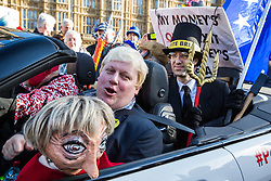 London, UK. 14th February, 2019. Boris Johnson lookalike Drew Galdron, also known as Faux BoJo, and a man disguised as Jacob Rees-Mogg join anti-Brexit activists protesting outside the Houses of Parliament in Westminster.