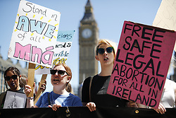 © Licensed to London News Pictures. 10/06/2017. London, UK. London-Irish Abortion Rights campaigners protest against Prime Minister Theresa May's new government and a coalition with the DUP in Parliament Square, London on Saturday, 10 June 2017 as the UK snap general election leads to a hung parliament. Photo credit: Tolga Akmen/LNP