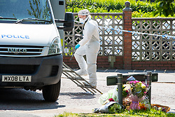 © Licensed to London News Pictures. 28/05/2018. Stockport, UK. A forensic scenes of crime examiner works at the scene outside The Salisbury Club on Truro Avenue in the Brinnington area of Stockport, Greater Manchester, where a car collided with pedestrians late last night, killing one man and injuring others.  A murder investigation has been launched. Police later recovered a black Audi A4 which fled the scene. Photo credit: Joel Goodman/LNP