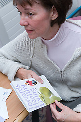 Patient holding a booklet about healthy living,