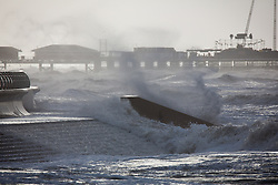"© Licensed to London News Pictures . 10/12/2014 . Blackpool , UK . Choppy waves crash on to the seafront . An explosive cyclogenesis - a fast developing storm in which air pressure falls rapidly - known as a "" weather bomb "" - hits the North of England , bringing storms to the region . Photo credit : Joel Goodman/LNP"