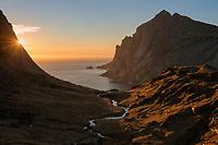Summer sun shines over hidden valley above Bunes beach, Moskenesøy, Lofoten Islands, Norway