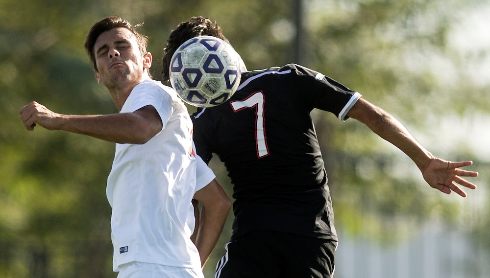 Orange Coast College's Taylor Kane (left) and Santa Ana College's Matheus Cuhna head the ball during their soccer game at Santa Ana College in Santa Ana, Calif. on Nov. 4, 2016.