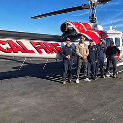 "Dwayne Johnson releases a photo on Instagram with the following caption: ""Good to shake hands with the Helitack 101 boys who\u2019ve been putting out our Southern California fires. \nThank you for your committed work, stay safe and I\u2019ll see you down the road."". Photo Credit: Instagram *** No USA Distribution *** For Editorial Use Only *** Not to be Published in Books or Photo Books ***  Please note: Fees charged by the agency are for the agency's services only, and do not, nor are they intended to, convey to the user any ownership of Copyright or License in the material. The agency does not claim any ownership including but not limited to Copyright or License in the attached material. By publishing this material you expressly agree to indemnify and to hold the agency and its directors, shareholders and employees harmless from any loss, claims, damages, demands, expenses (including legal fees), or any causes of action or allegation against the agency arising out of or connected in any way with publication of the material."