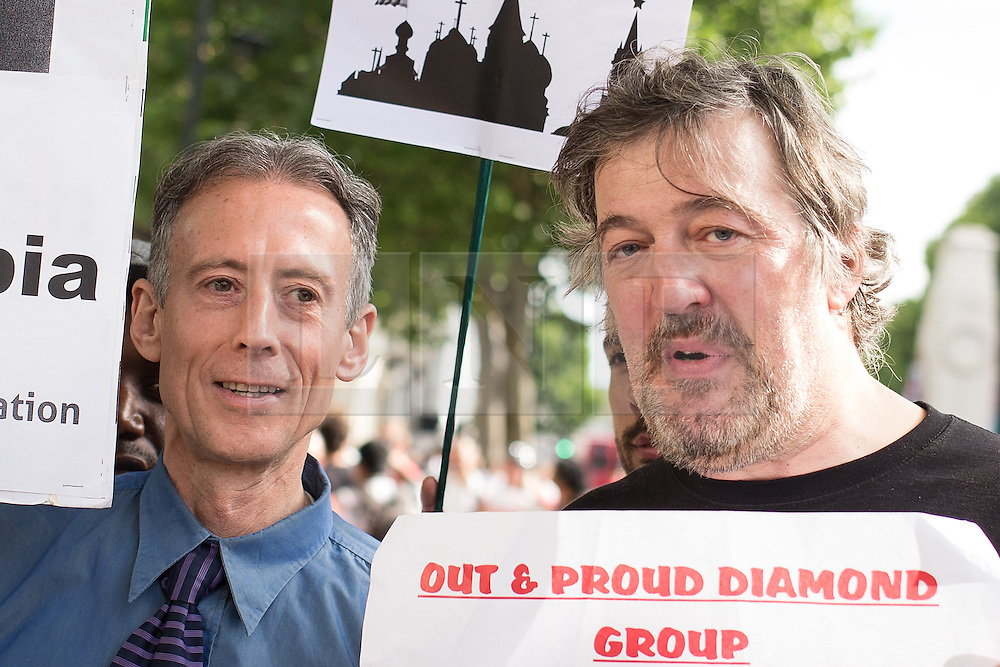 """© Licensed to London News Pictures . 10/08/2013 . London , UK . PETER TATCHELL and STEPHEN FRY at the demonstration . Protesters with placards . Demonstration against homophobic laws being enacted in Russia on Whitehall this afternoon (10th August 2013) . Legislation includes banning gay pride events for100 years , banning the distribution of """" propaganda of non-traditional sexual relations """" to minors , making it illegal for the adoption of Russian children by gay couples or any single person who comes from a country that recognises marriage equality and giving authorities the rights to arrest foreign nationals whom they suspect are LGBT or pro gay with the right to detain them for up to 14 days. Photo credit : Joel Goodman/LNP"""