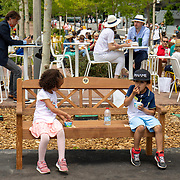 PARIS, FRANCE June 12.  Two children enjoy ice cream on a park bench in the grounds of Roland Garros during competition at the 2021 French Open Tennis Tournament at Roland Garros on June 12th 2021 in Paris, France. (Photo by Tim Clayton/Corbis via Getty Images)