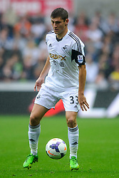 Swansea Defender Ben Davies (WAL) in action during the first half of the match - Photo mandatory by-line: Rogan Thomson/JMP - Tel: Mobile: 07966 386802 17/08/2013 - SPORT - FOOTBALL - Liberty Stadium, Swansea -  Swansea City V Manchester United - Barclays Premier League - First round of the 2013/14 season and the first league match for new Man Utd manager David Moyes.