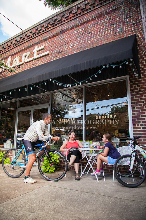 """"""" 10 Great Bike Rides """" feature, opener, family of cyclist at Stella's Grocery Cafe in The Fan"""