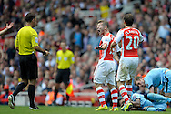 Arsenal's Jack Wilshere angry with Referee Mark Clattenburg decision to award Manchester City a free kick. Barclays Premier league match, Arsenal v Manchester city at the Emirates Stadium in London on Saturday 13th Sept 2014.<br /> pic by John Patrick Fletcher, Andrew Orchard sports photography.