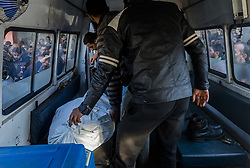 February 6, 2018 - Srinagar, Jammu and Kashmir, India - SRINAGAR, KASHMIR, INDIA - FEBRUARY 6: Paramedics and Indian policemen in civvies carry the body of Indian policeman on a gurney after he was killed  by a Pakistani militant killed  and escaped form the spot on February 6, 2018 in Srinagar, the summer capital of Indian administered Kashmir, India. A Pakistani militant of  Lashkar-e-Taiba  who was under Indian police custody managed to escape after a daring attack while being taken to Srinagar's Shri Maharaja Hari Singh Hospital (SMHS)  after an Indian police party escorting prisoners came under attack. Two Indian policemen were killed after suspected militants opened fire at their party escorting prisoners to SMHS Hospital. The Indian police party was bringing around five prisoners from Kashmirs Central Jail for a routine medical check-up in the hospital when it came under attack. The escaped militant has been identified as Naveed Jat , also known as Abu Hanzulla, arrested from south Kashmir in 2014. Reportedly Naveed has decamped with the rifle of one of the wounded Indian policeman.  (Photo by Yawar Nazir/Nur Photo) (Credit Image: © Yawar Nazir/NurPhoto via ZUMA Press)