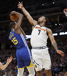 October 21, 2018 - Denver, Colorado, U.S - Nuggets TREY LYLES, right, defends against Warriors KEVIN DURANT, left, under the basket during the 1st. Half at the Pepsi Center Sunday night. The Nuggets beat the Warriors 100-98. (Credit Image: © Hector Acevedo/ZUMA Wire)