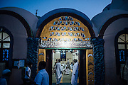 """Nubians gathering & waiting in a mosque for """"Katb Al Kitab"""" event of """"matrimony contract"""" the legal aspect of an Islamic marriage"""